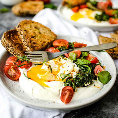 Turkish Eggs With Greek Yogurt and Sautéed Spinach
